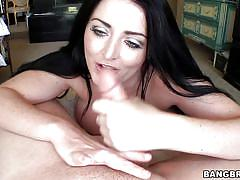 Sophie dee giving handjob to a guy