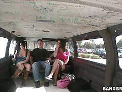 Two girls having fun in the bang bus