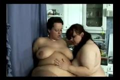Fat lesbian sex in kitchen