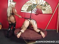 Bound asian babe slave girl getting her ass toyed.