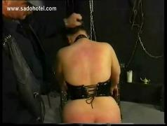 Chubby slave is spanked on her ass and plays with her pussy and clit