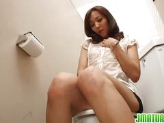 Hairy japanese milf matures in public toilet.