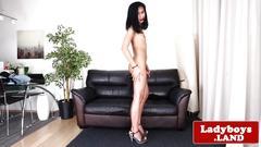 Solo ladyboy sensually strips and wanks cock