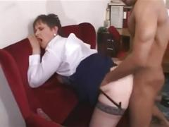 Mature woman fucked by a young cock