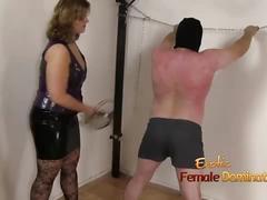 Merciless mistress flogs her slave too hard