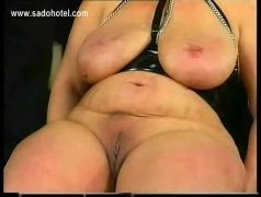 Fat slave with large tits gets spanked on her balt pussy