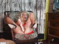 Horny blonde slut in latex fucks pussy with big sex toy in burntout house
