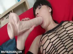 Courtney stretches her pussy with two brutal toys