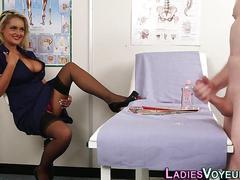 Sexy clothed nurse stares