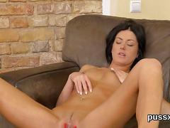 Brunette with a landing strip pussy poses and toys naked