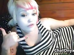 Blonde emo cam girl smokes