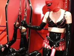 Cybill troy: suspended rubber gimp fisting & strapon fucking