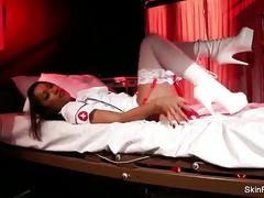Skin diamond plays naughty nurse in the solo.