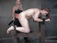 Voluptuous redhead gets a red ass from the flogger