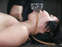 Flexible babe squirts upside down in rope bondage