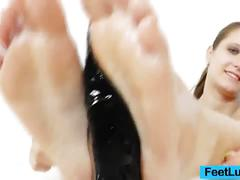 Jennifer amton gives a slippery footjob to a toy
