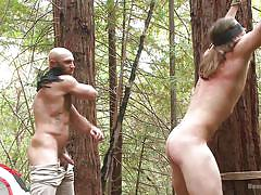 Gay slave is whipped in the woods