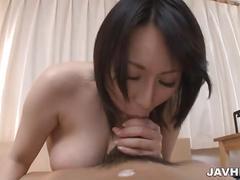 Bosomy chick masturbating before giving a titjob