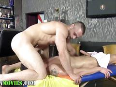 Oiled up dude getting boned by his hunky masseur bareback