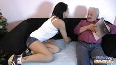 The young girl is teasing the old man to get her fucking gift for the christmas