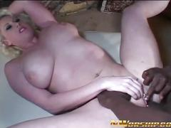 Busty milf sucks and gets rammed by black dick.