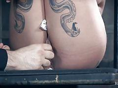 Buxom brunette babe in rope bondage with pretty feet displayed