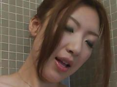 Asian slut rubs her shaved pussy