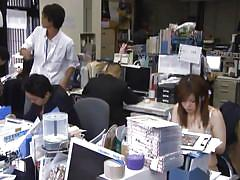 Asian woman undresses at her workplace