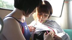 Asian lesbians play on a bus
