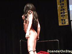 Busty flexible stripper on stage