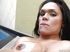 Oiled latina shemale has a firm grip on her throbbing pecker