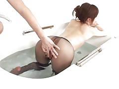 Nasty japanese lady shows off her stunning legs in the tub