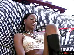 Black shemale with puffy nipples inserts sex toy in the ass
