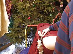 Erin gets fucked from behind in front of christmas tree