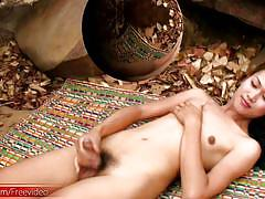 Teen ladyboy with small tits strips naked outdoors and jerks