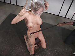 Submissive rain degrey restrained in hard bondage