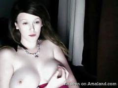 Webcam beauty teases the camera playing with her nipples