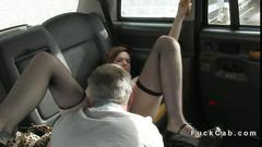 Redhead in stockings fucked in a cab