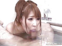She gives a nice titjob in the tub