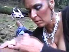 Mature blowjob in the wood