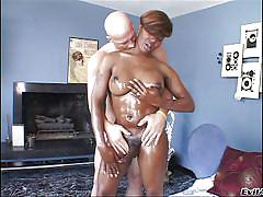 Black tranny juggles her boobs