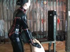 Latex domina trains her slave object to obey and worship 01