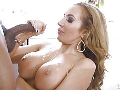 Huge breasts covered in a black man's cum