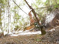 Bound hunk gets sucked off in the woods