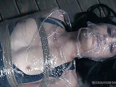 bdsm, babe, brunette, suspended, upside down, suffocation, mouth gagged, rope bondage, shrink wrap, real time bondage, lydia black