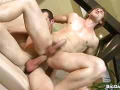 Muscled hottie rides thick cock bareback