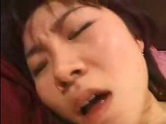 Asian lesbian sucks and fucks with a strapon