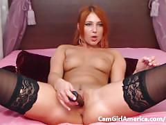 Horny fit redhead babe plays with her pink pussy