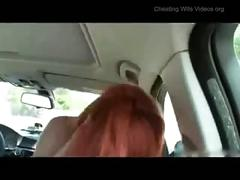 Redhead in a car fucking and sucking