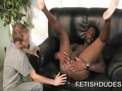 Muscled black dude toys his ass